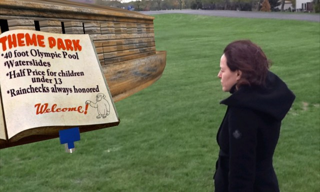 Melissa reads the Noah's Ark Theme Park Sign